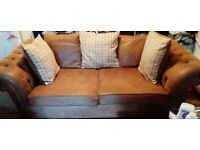 1 two seater and 1 three seater sofa (simulacra to a chesterfield