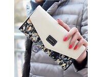 Love's designer patterned clutch purse