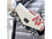 LOVE'S DESIGNER PATTERNED CLUTCH PURSE