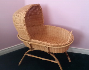 Antique wicker doll bassinet