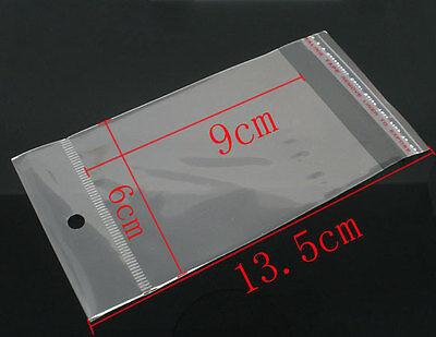 200 X Clear Self Adhesive Cello Bag Hole Jewellery 13.5cm X 6cm External Q62
