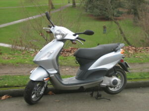 2009 Silver Piaggio Fly 150. Low kms. Very good condition.