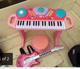 Pink keyboard and guitar
