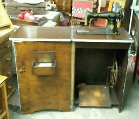 Vintage boxed singer treadle sewing machine.