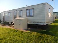 Caravan to hire/ rent @ cayton Bay sleeps 8 pets allowed