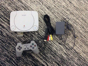 PlayStation 1 console with controller and memory card