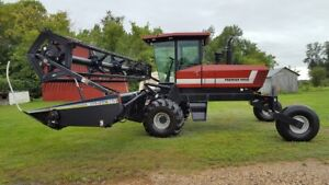 Macdon 2920 swather with pull roller