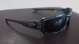 Oakley Sunglasses. Five's Crystal Black frame with Polarized Lenses