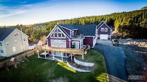 Perched on 2.53 ac in Logy Bay, 5 bed/3 bath waiting for YOU!