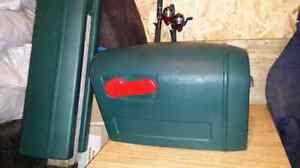 Green plastic mailbox