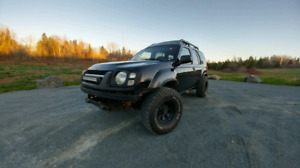 2004 Nissan Xterra w/aftermarket wheels & tires. Trade or sell.