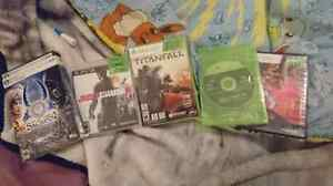 3 xbox 360 games, 1 ps3, 1 computer game