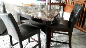 Triangular guitar pick shaped table and seats $300
