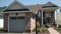 Updated cozy split level bungalow with main level Masterbed