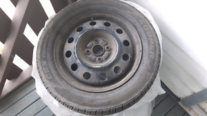 Set of 4 tires on rims - 185/60/R15