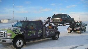 TIRED OF WAITING HOURS FOR HOURS? CALL TAGG'S EXTREME TOWING!