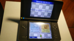 Nintendo DSi XL Bronze and games