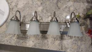 Like new 4 bulb bathroom sconce light fixture