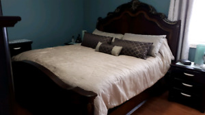 King size bed frame, boxspring and bedding.