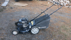 2 push mowers for trade for a rideon