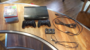 500gb ps3 with 6 games, 2 controllers, charging doc and hdmi