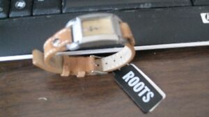 "Roots Womans Watch,New""was $100 price tag still on it!"