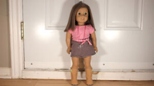 American Girl doll, brown hair, blue eyeds with outfit