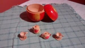 Vintage wooden apple with miniature tea set inside