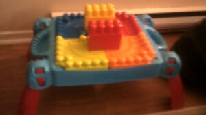 Baby jumper and mega blocks table