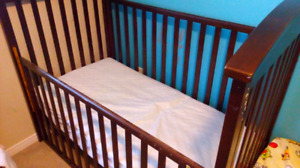 Crib with mattress and water proof cover