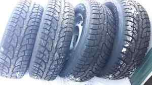 BRAND NEW P26570R17 WINTER TIRES AND RIMS