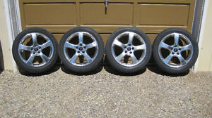 4 rims and 5 tires for sale
