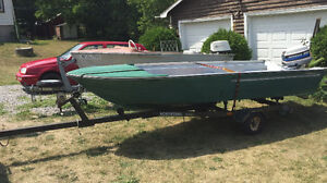 14' peterborough and 1982 20 evinrude ss 2 stroke/w/trailer