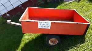 Small trailer for behind a riding lawn mower or quad