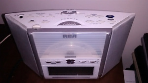 RCA CD player, radio, alarm clock