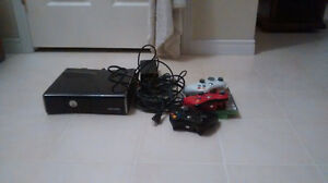 Xbox 360 with three controllers, Halo 3, and all cords