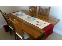 Solid oak table and chairs with matching sideboard.