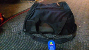 Soft-shell dog carrier and other dog items
