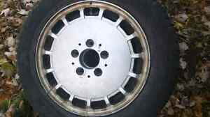 Mercedes 15 inch all season tire on an aluminum rim for sale London Ontario image 1