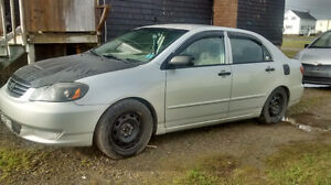 04 Toyota Corolla  for parts or repair lots of aftermarket parts