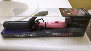 Brand new never used mini curling iron