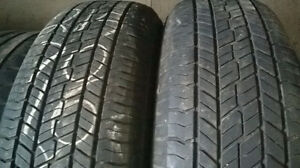 Two Yokahama 215 70 16 all season tires.