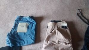 New and used large  bag of Mens clothing, size 32
