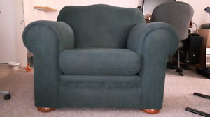 Large comfortable dark green chair