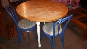 Old round table and two chairs