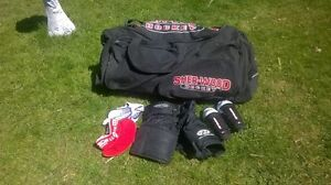 Hockey bag and a knee and neck pads For Sale