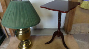 brass table lamp and plant table