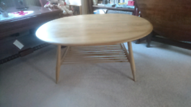 A large oval ercol coffee table