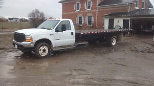 FORD F 550 21 FOOT FLATBED DUALLY