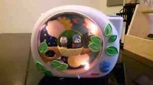 Fisher price mobile with light, music, projects on to ceiling